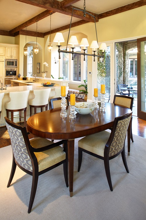 The den, breakfast room and kitchen remain open to one another, creating a wonderful long-range view across the house.