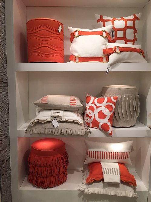This linen showroom displayed quite the pop of color with orange pillows and ottomans.