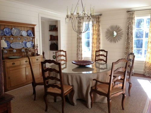 Horizontal ship lap paneling in a soft white has an understated elegance in this dining room.
