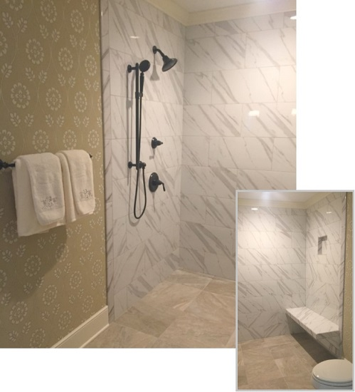 A curbless shower and tiled bench create an open shower in the master bath.
