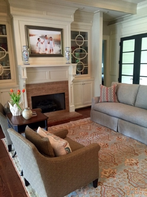 The addition of a new sofa and pillows add warmth to the living room.